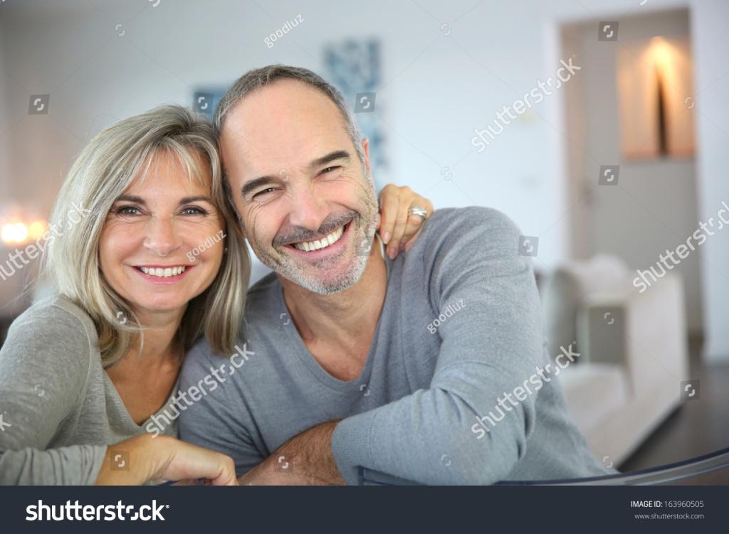 stock-photo-cheerful-senior-couple-enjoying-life-163960505 (1)