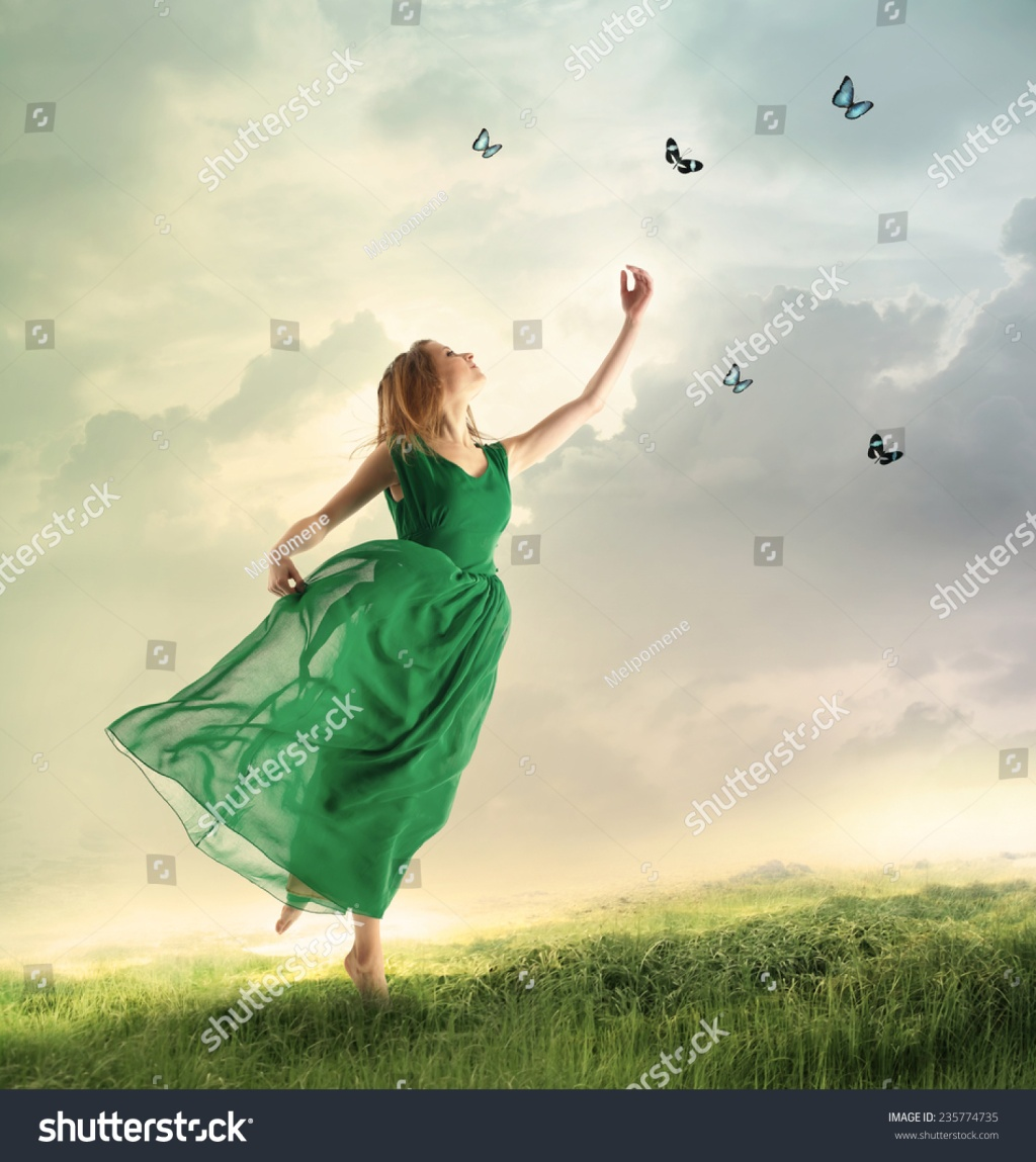 stock-photo-beautiful-woman-in-a-green-dress-chasing-butterflies-on-a-mountain-235774735